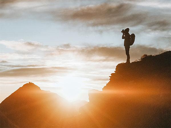 sunlit silhouette of hiker